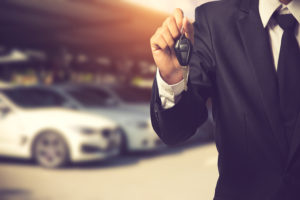 businessman showing car key