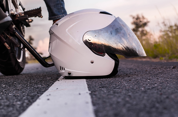 White motorcycle helmet on the road
