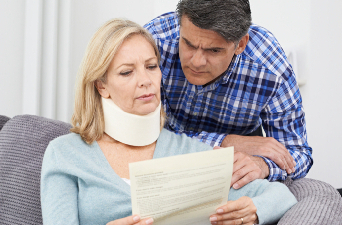 Couple reviewing medical bills after an accident