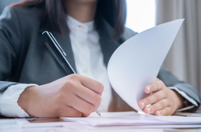 A woman filing a claim