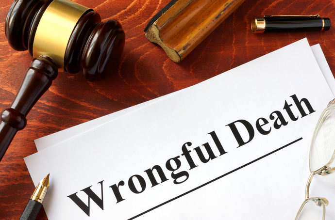 Wrongful death text on paper with a pencil and a gavel