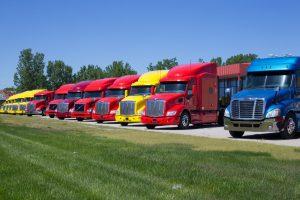 semi-tractor trailer trucks in parking lot